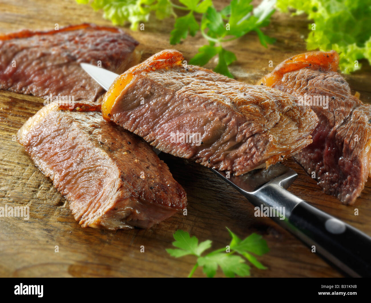 sirloin beef steak - well done - Stock Image