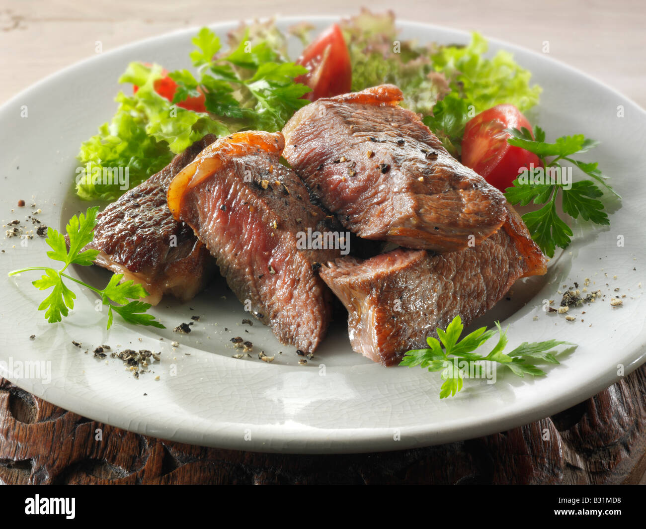 sirloin beef steak and fresh mixed salad - Stock Image