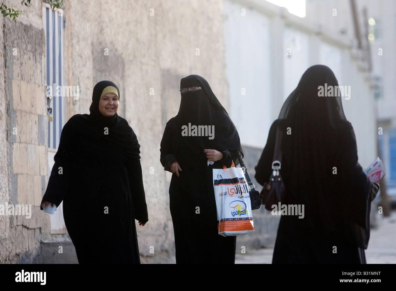 Muslim women wearing Niqab and Chador - Stock Image