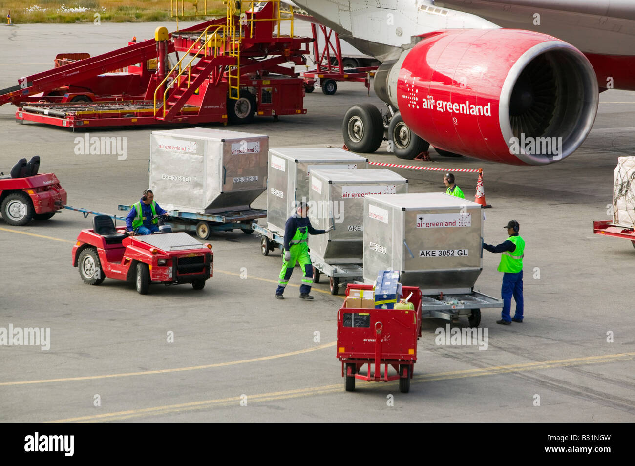 An air Greenland flight at Kangerlussuaq airport bringing freight and tourists to Greenland - Stock Image