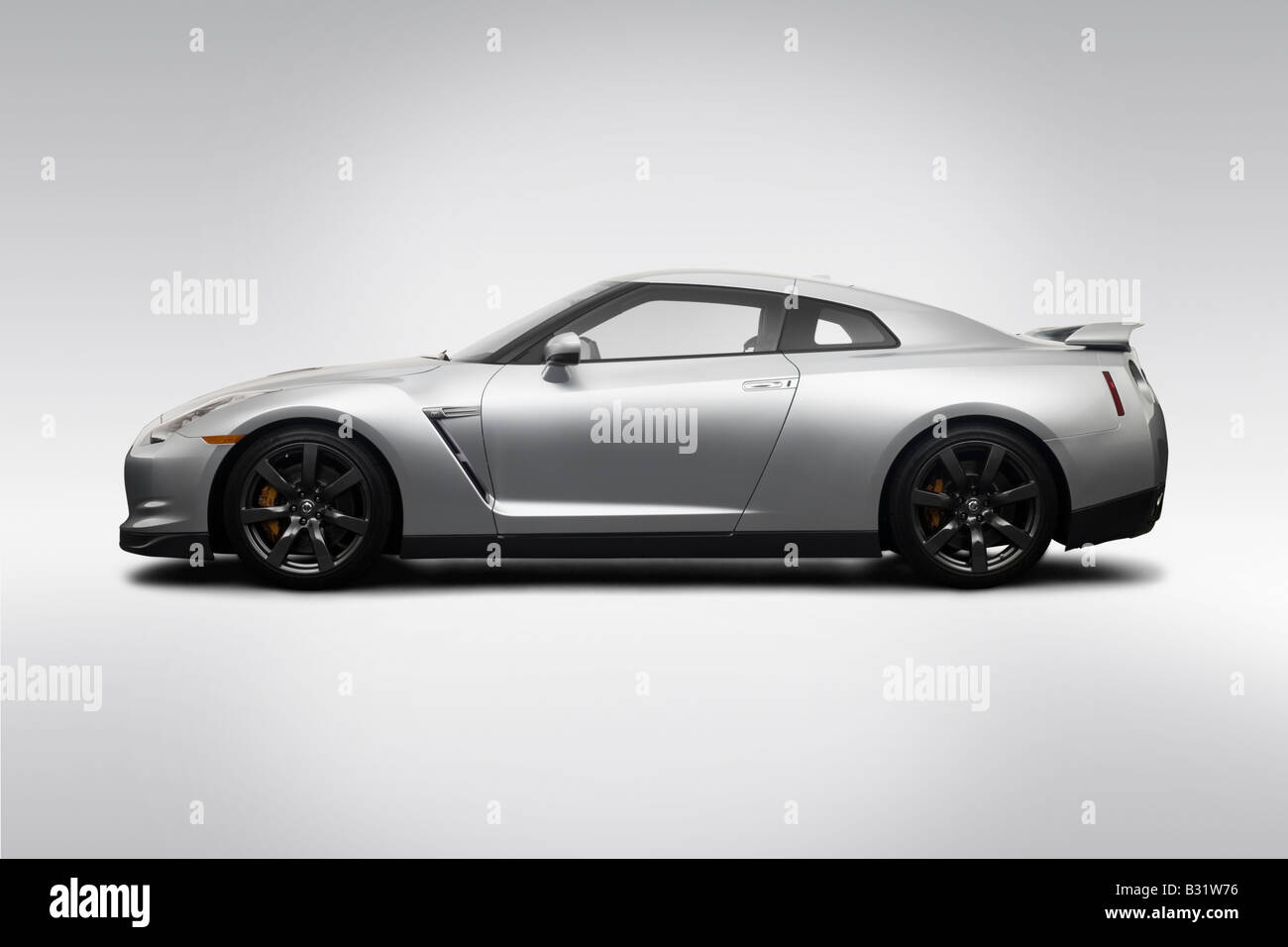 Awesome 2009 Nissan GT R In Silver   Drivers Side Profile   Stock Image
