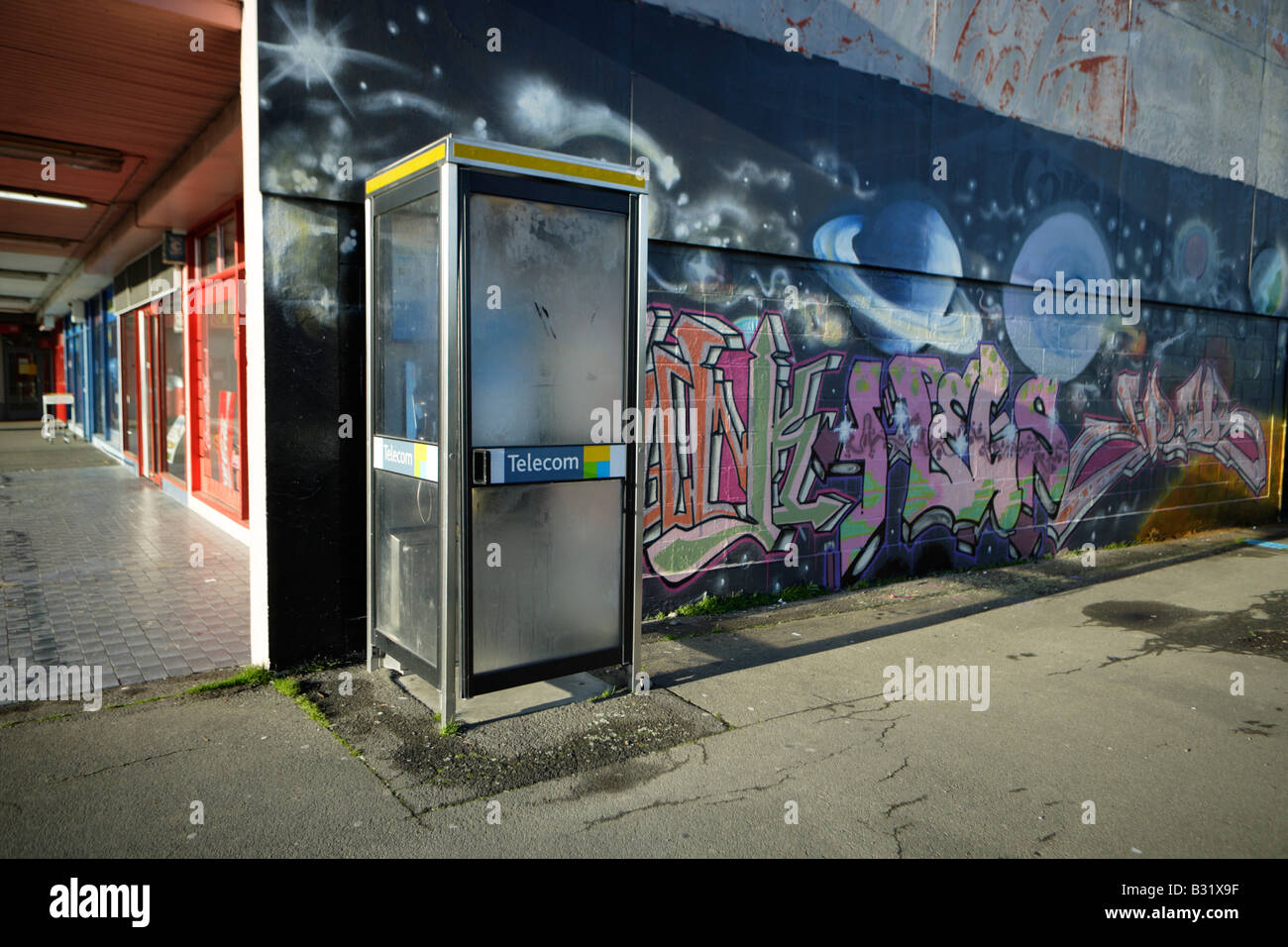 Telephone kiosk and graffiti art Urban landscape Palmerston North New Zealand - Stock Image