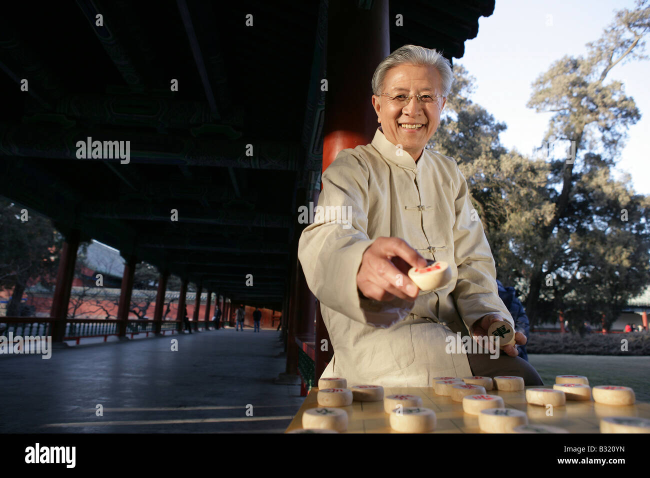 Chinese Senior Adult Playing Chess - Stock Image