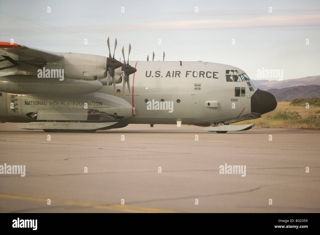 An American Air Force flight at Kangerlussuaq Airport on Greenland after a resupply flight to the ice sheet summit - Stock Image
