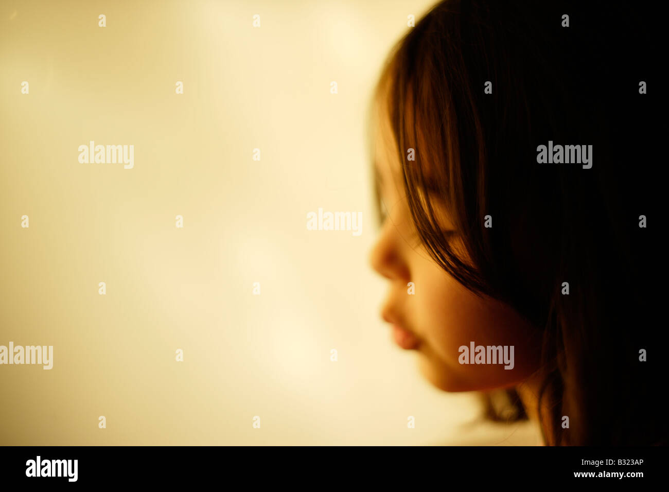Profile of five year old girl - Stock Image