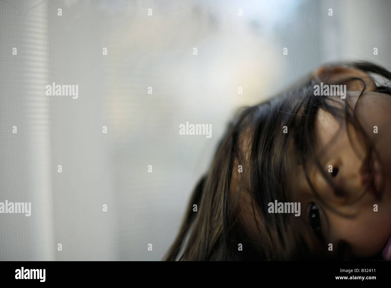 Portrait of five year old girl by window Mixed race Indian ethnic Stock Photo