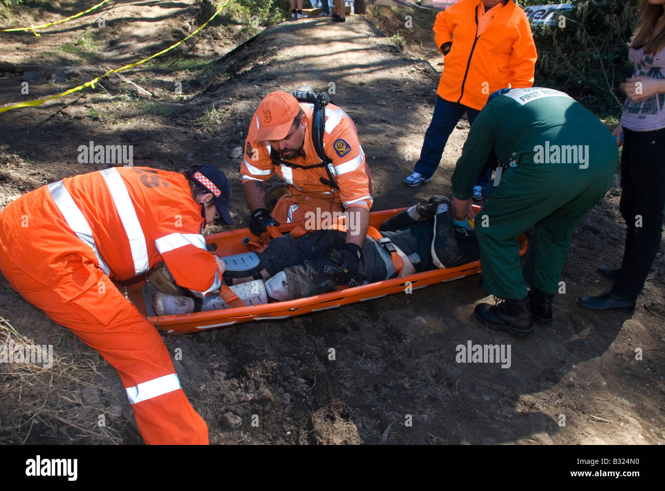 Medivac first aid and extraction of mountain bike rider - Stock Image