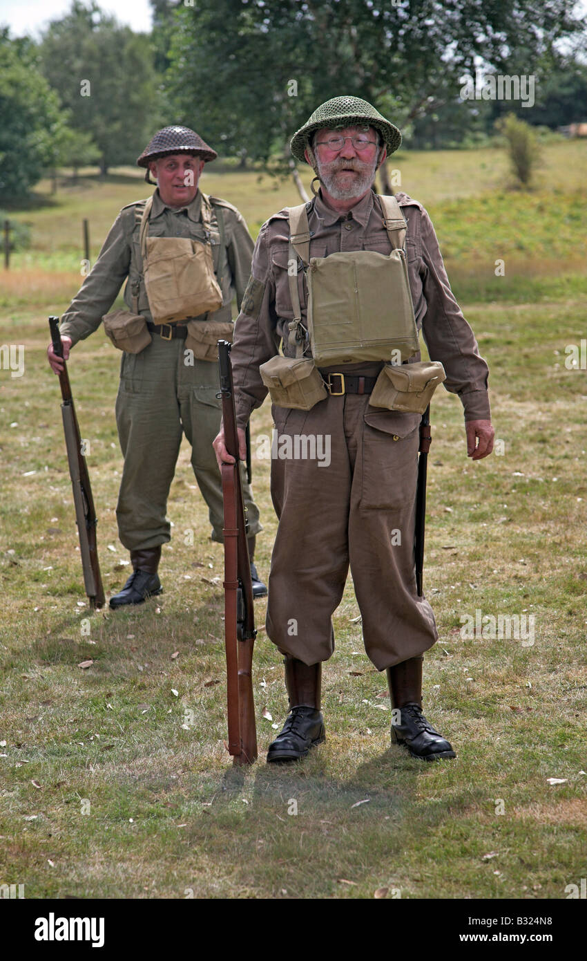 Two Home Guard soldiers stand to attention during 1940s re-enactment - Stock Image