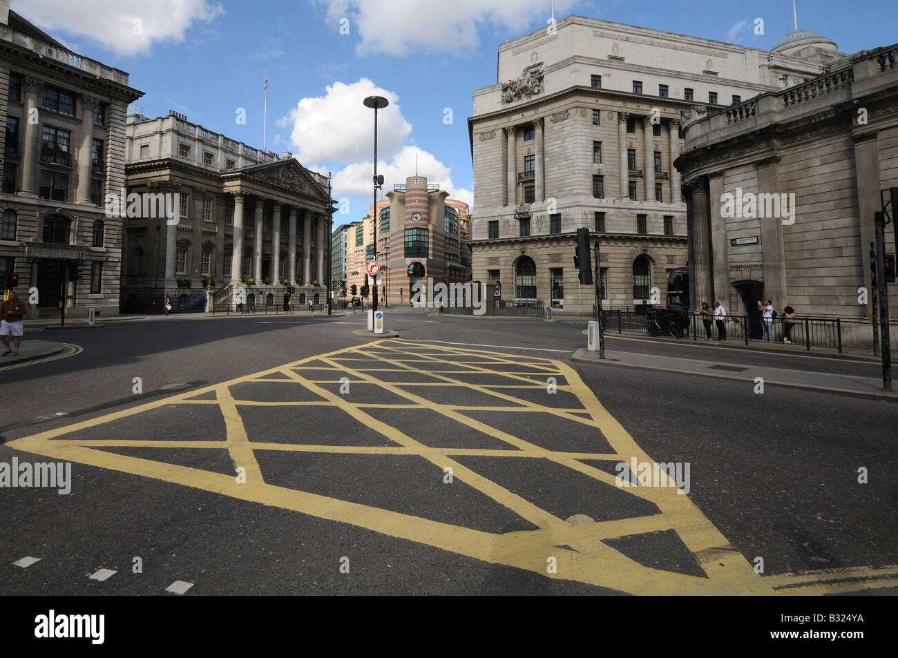 Mansion House and road junction including box junction from Bank of England city of London - Stock Image