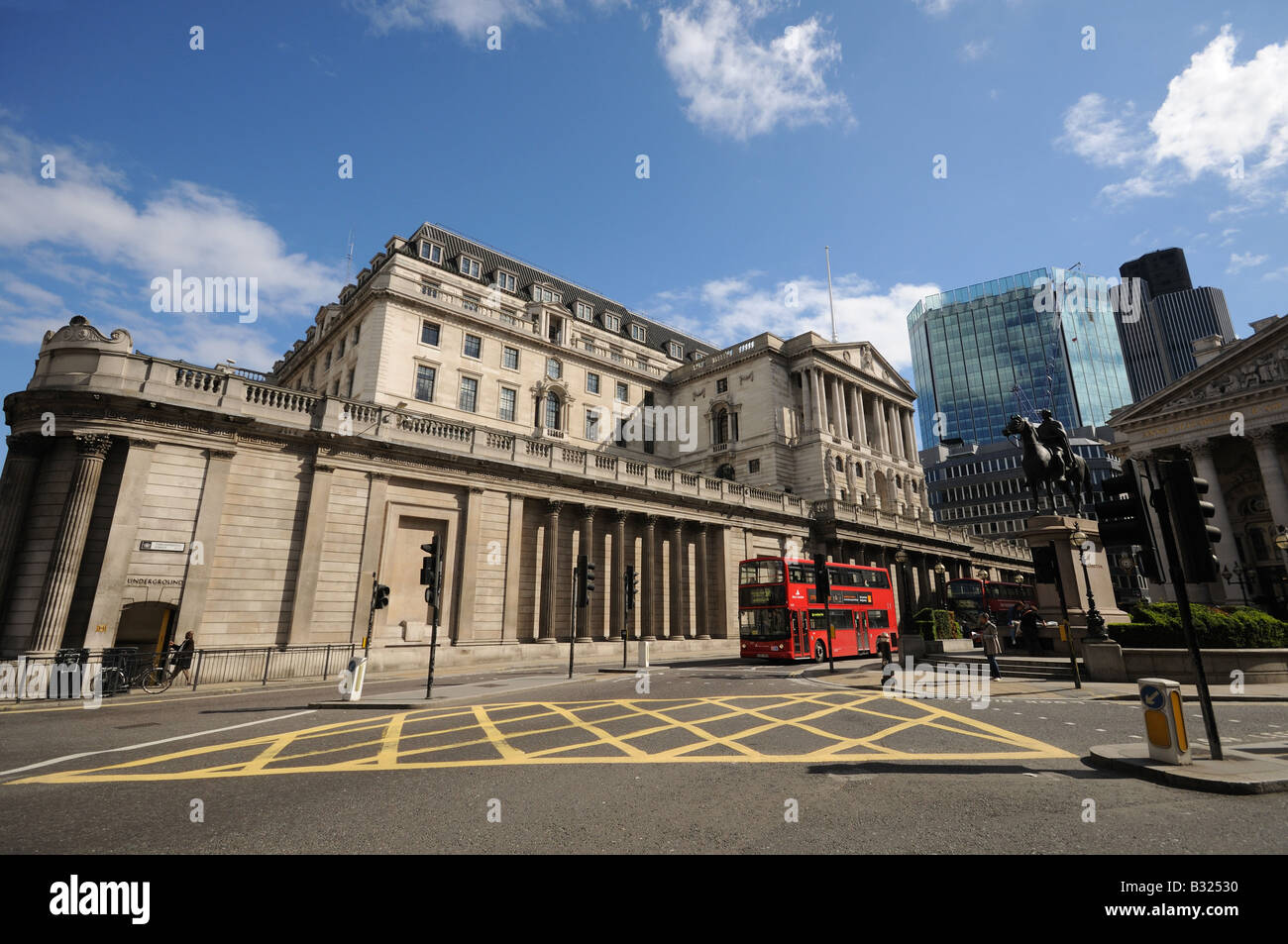 view of Bank of England threadneedle street from the mansion house road junction including box junction london england - Stock Image