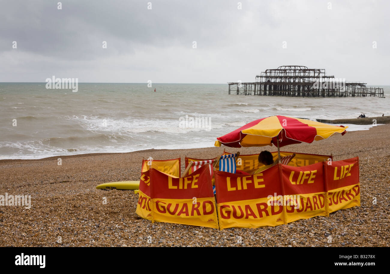 Lifeguard on a deserted Brighton beach, East Sussex, England - Stock Image