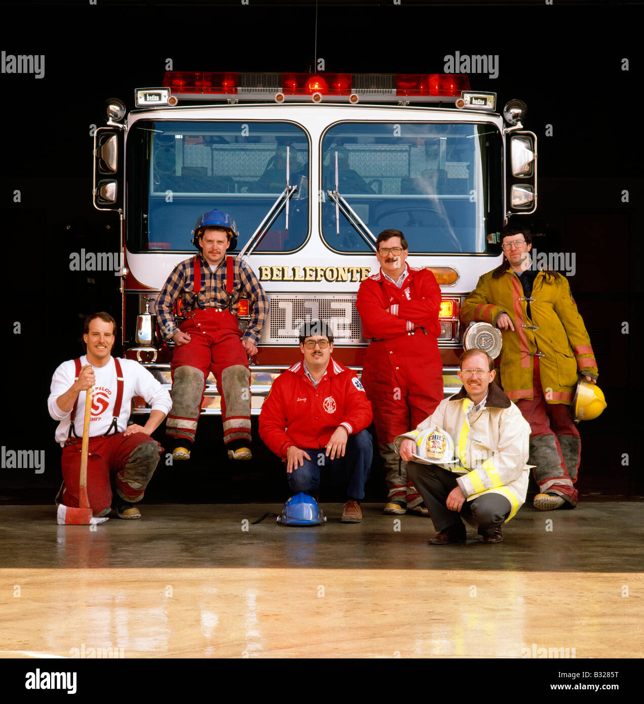 BELLEFONTE, PA, VOLUNTEER FIRE DEPARTMENT MEMBERS POSE IN FRONT OF A FIRE TRUCK - Stock Image