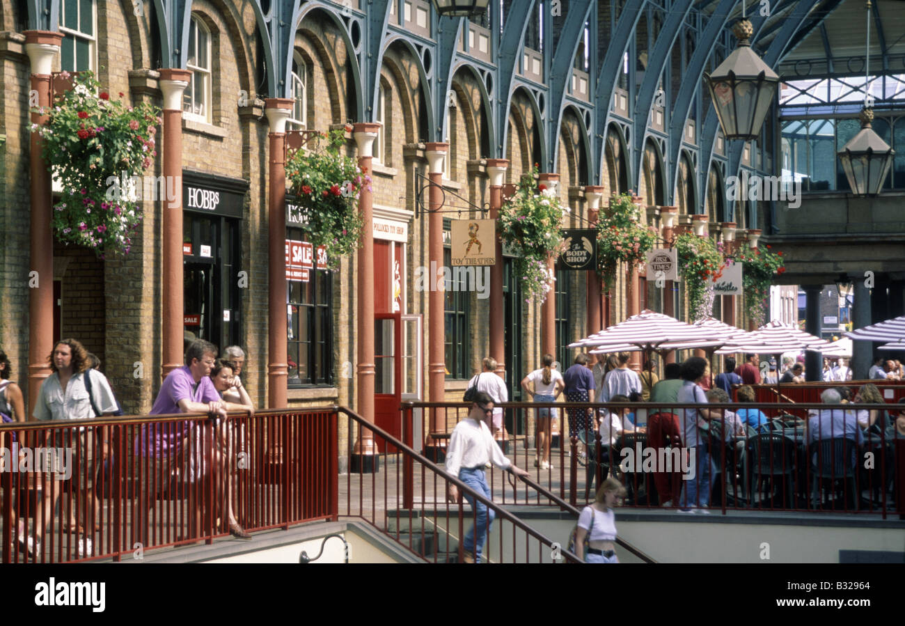 Covent Garden Shops Tables With Umbrellas Hanging Baskets People Stairs  Railings Lamps LONDON ENGLAND