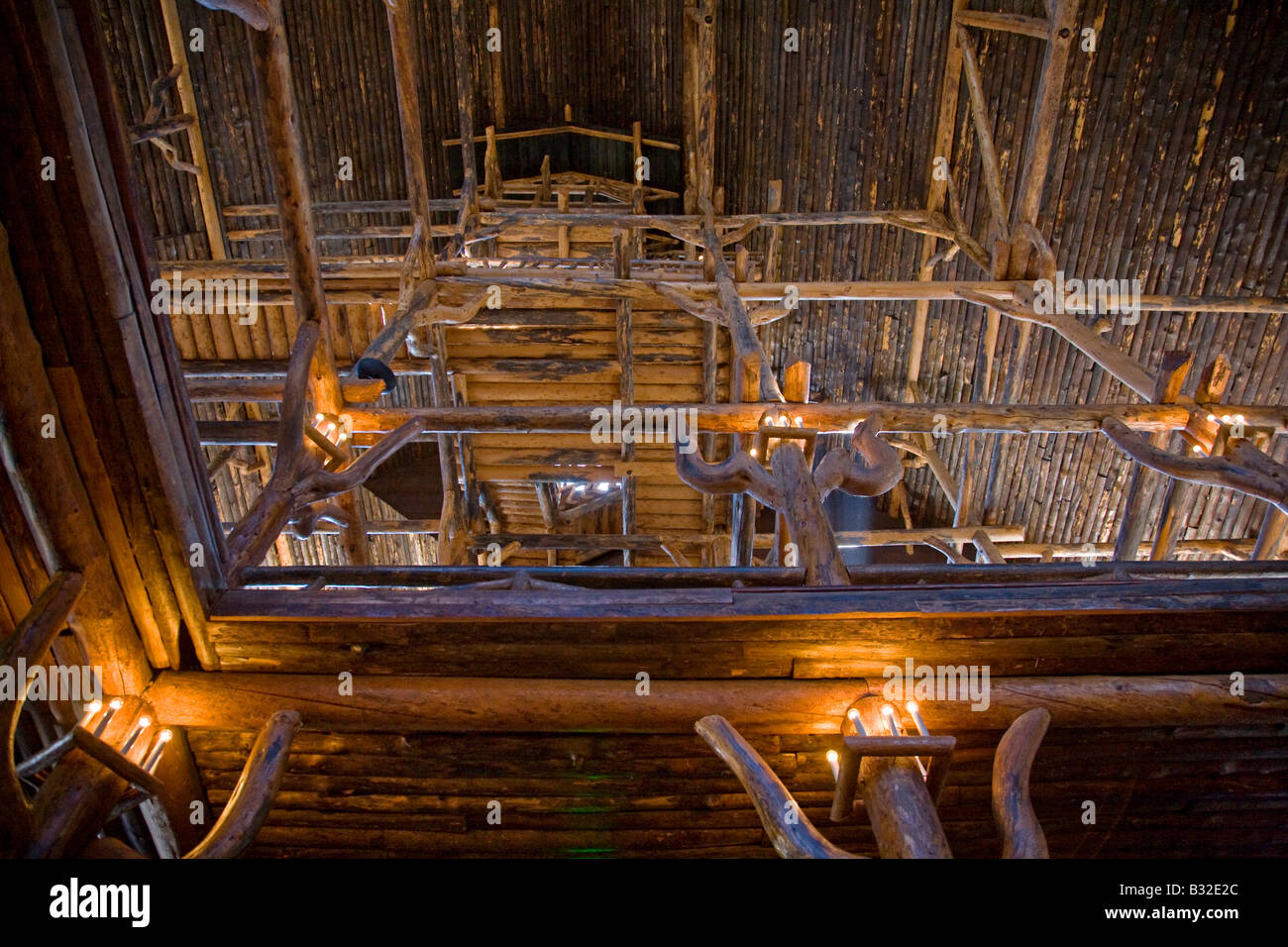 Log constructed interior of the historic OLD FAITHFUL INN was completed in 1904 YELLOWSTONE NATIONAL PARK WYOMING - Stock Image