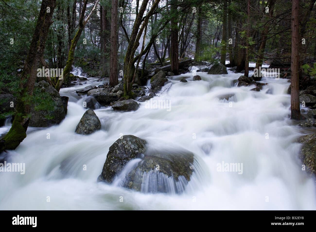 Heavy runoff from Bridalveil Falls combined with a slow shutter speed creates a mystical scene Yosemite National - Stock Image