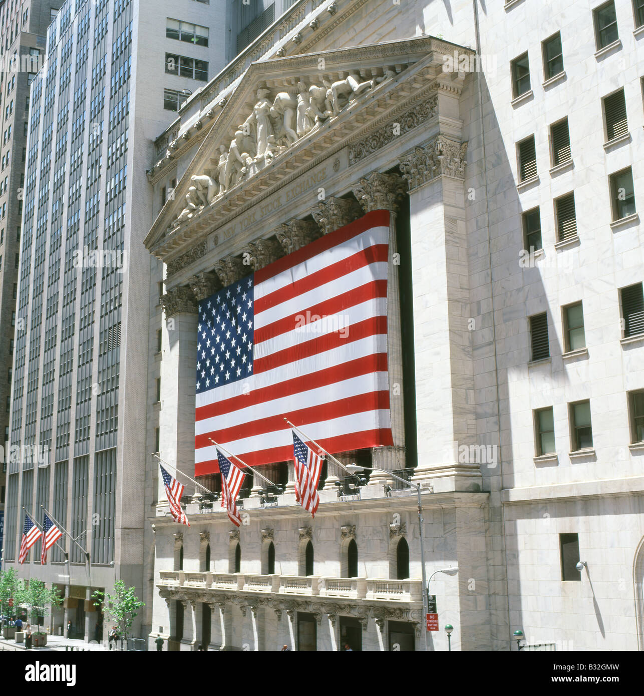 American flags draped on the exterior of the NYSE New York Stock Exchange building on Wall Street financial district - Stock Image