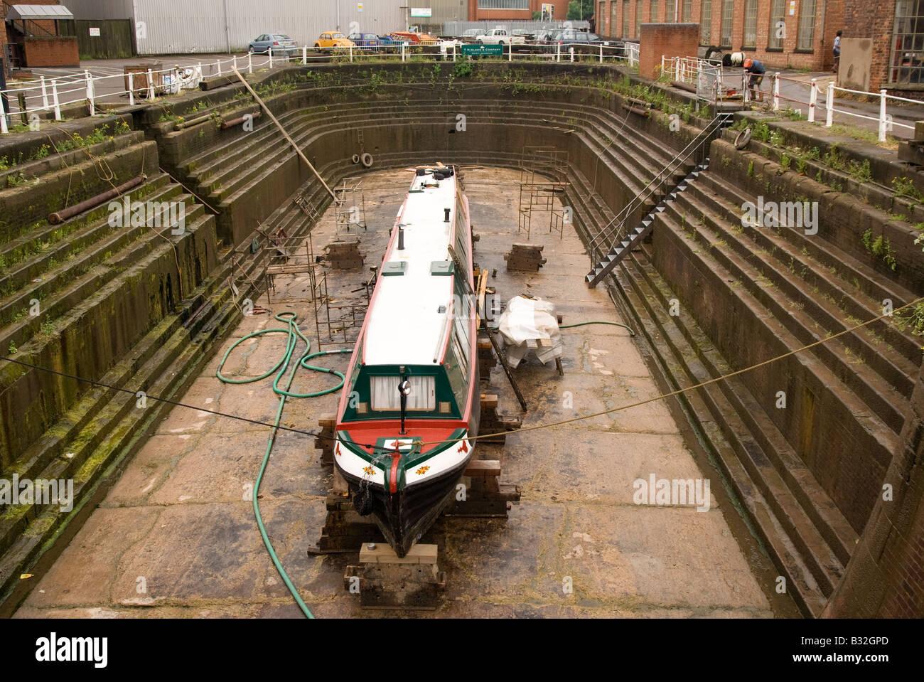 narrow boat in dry dock - Stock Image