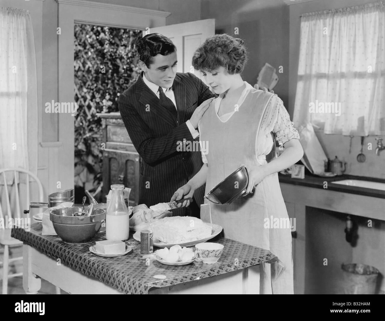 HELP IN THE KITCHEN - Stock Image
