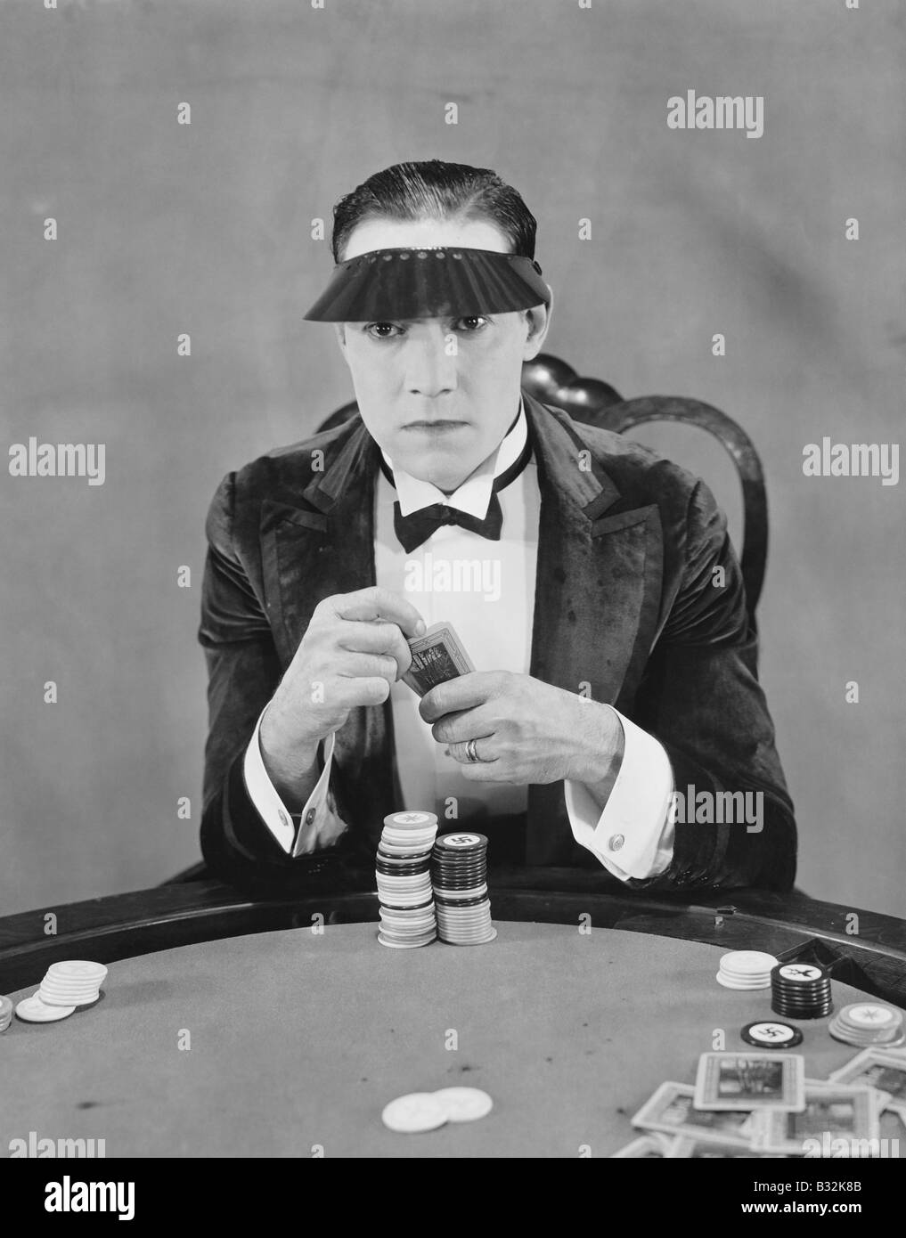 Portrait of gambler at card table - Stock Image