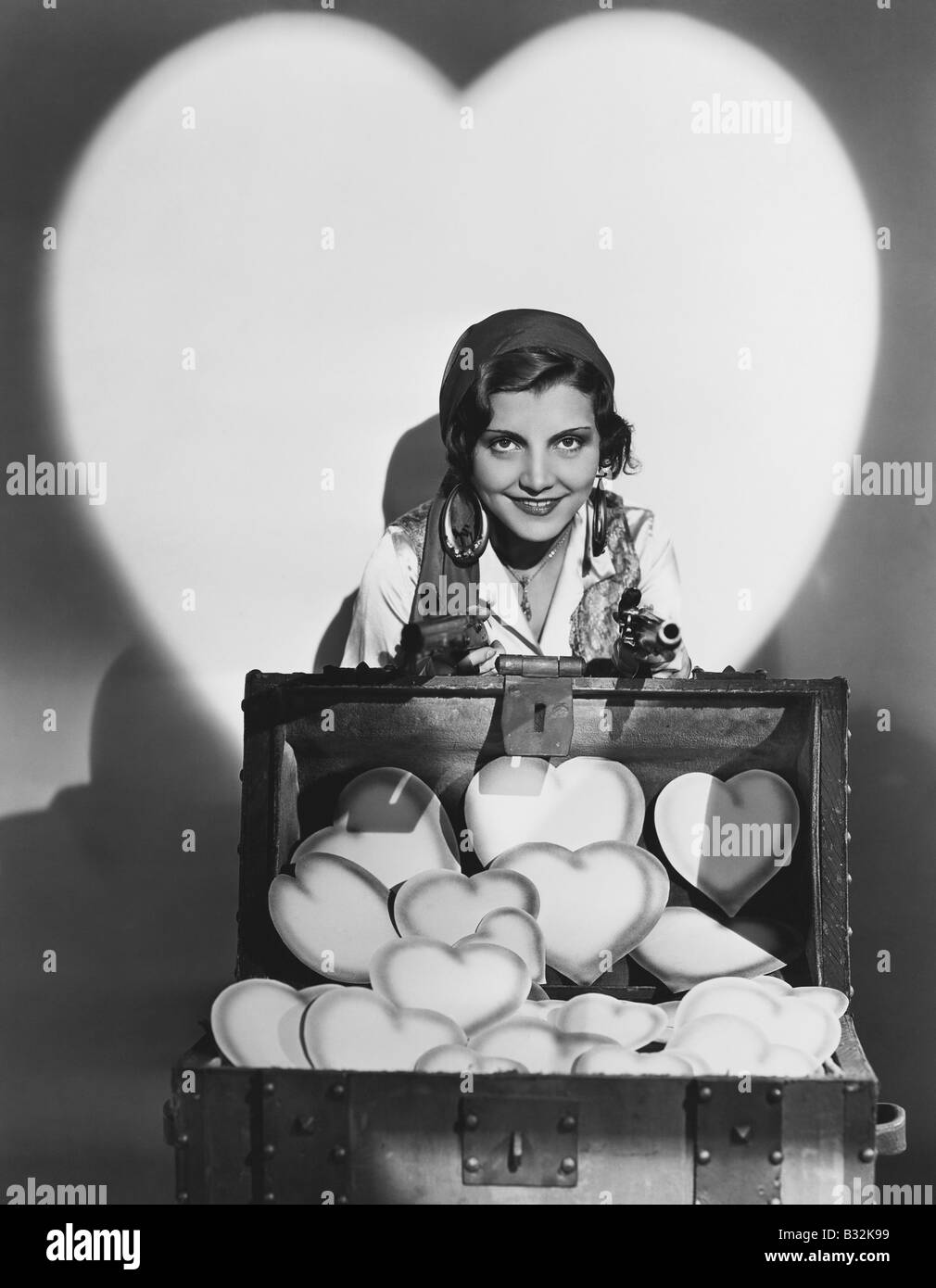 Portrait of woman with trunk full of hearts - Stock Image