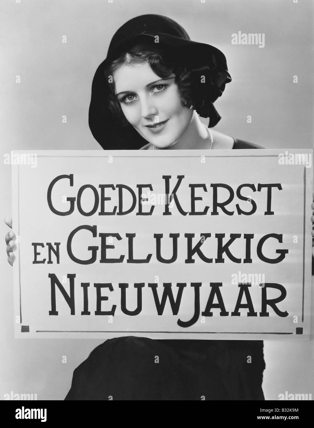 Woman holding sign written in Hungarian - Stock Image