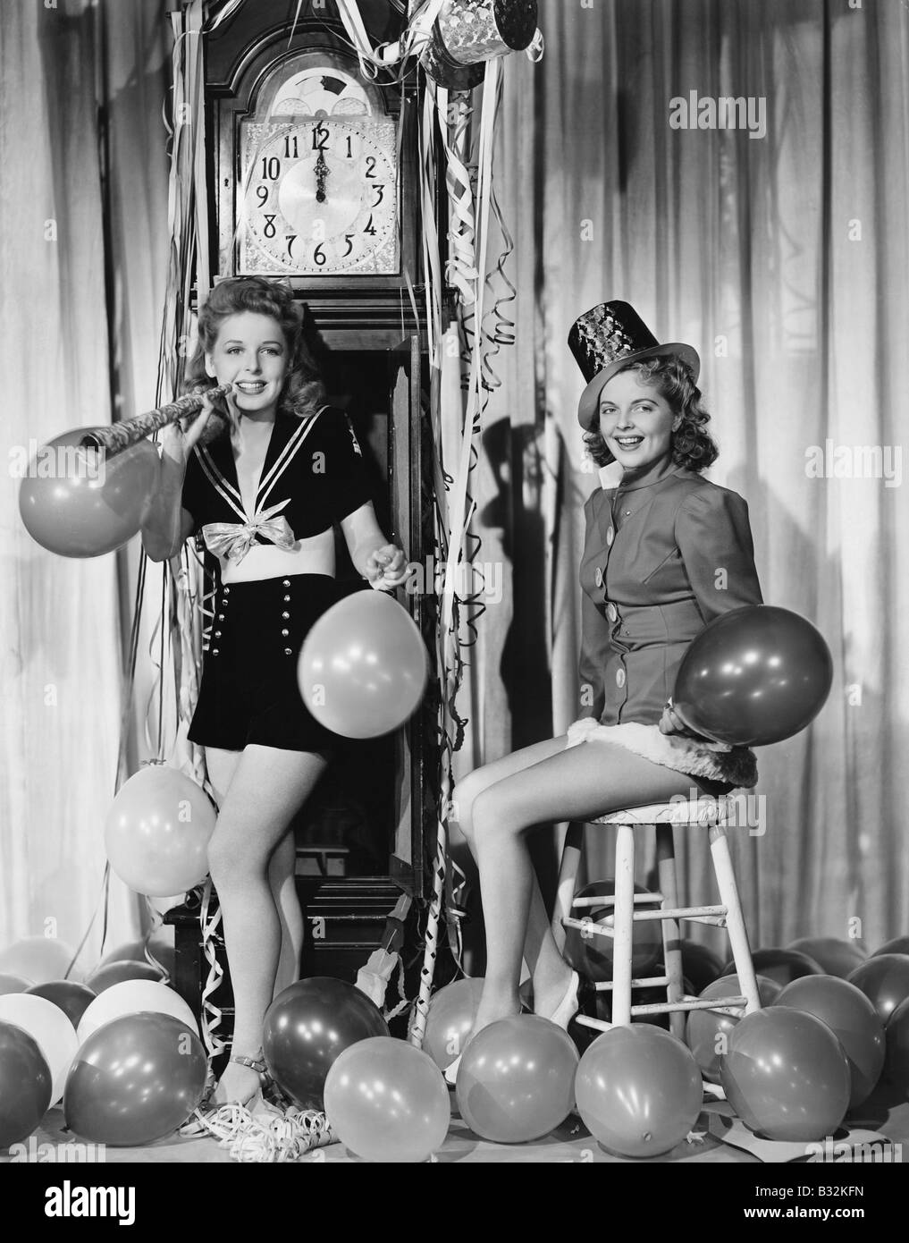 Women with balloons on New Years Eve - Stock Image