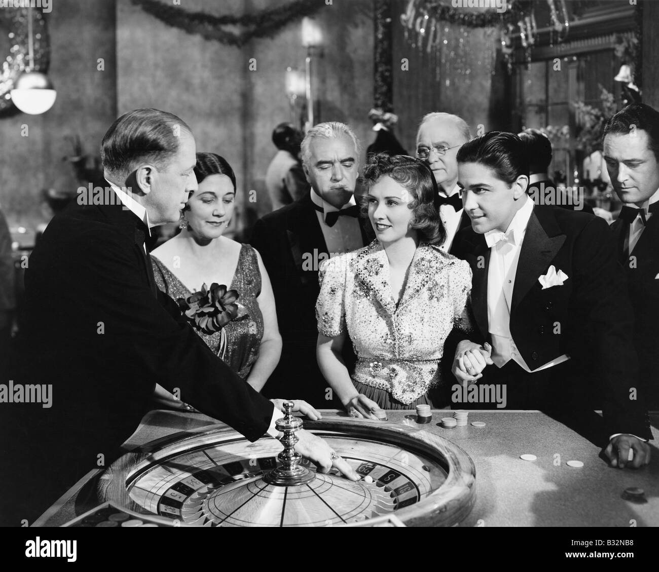 People at roulette table - Stock Image