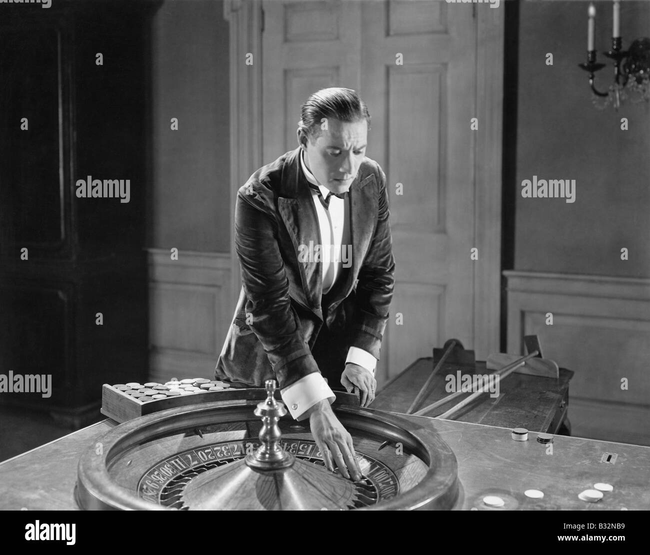 Man with roulette table Stock Photo