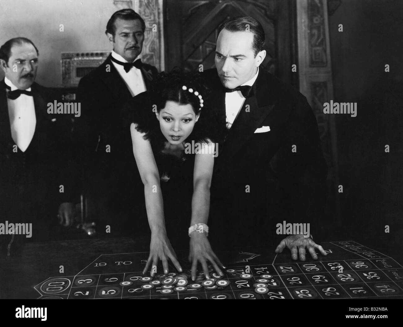 Shocked people at craps table - Stock Image