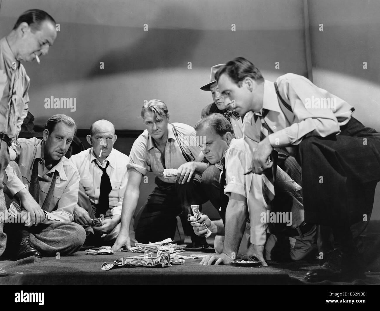Group of men gambling - Stock Image