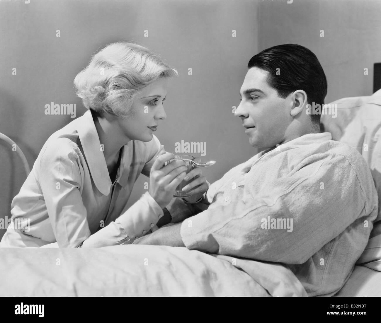 Woman feeding patient Stock Photo
