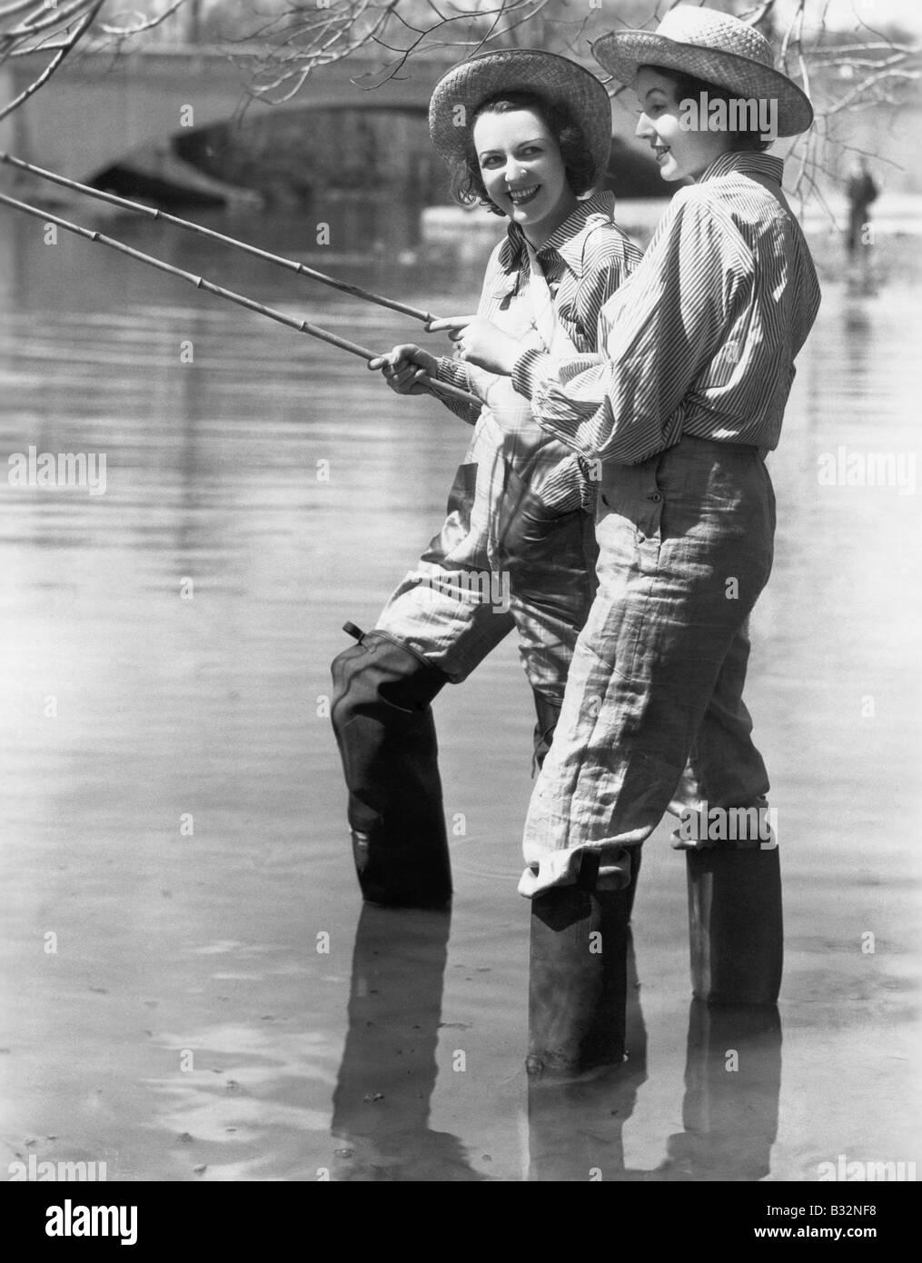 Two women fishing - Stock Image