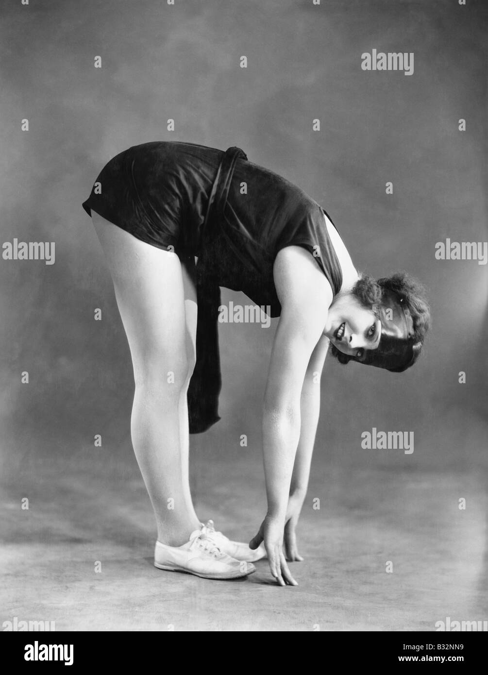 Woman touching toes - Stock Image