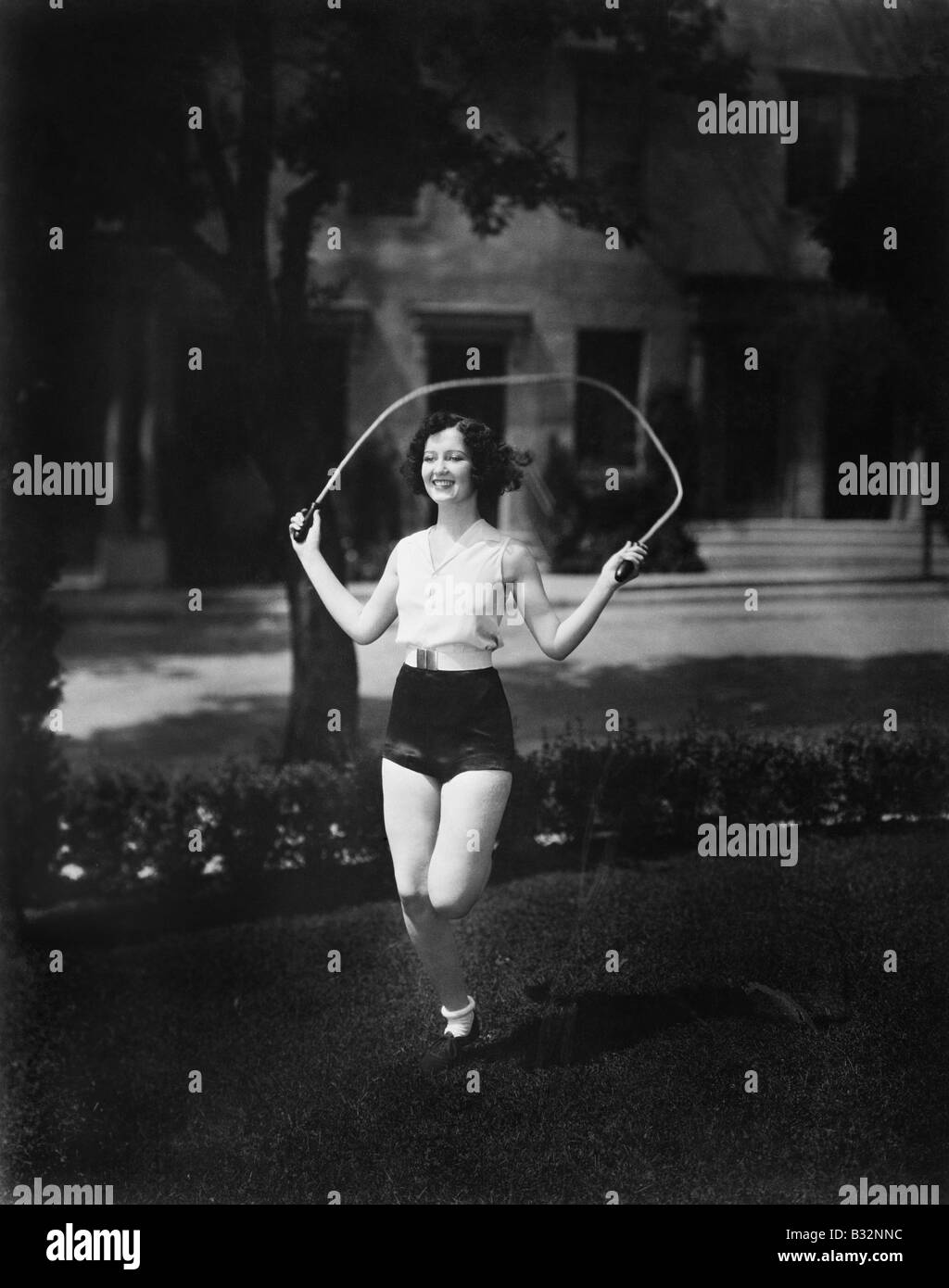 Woman jumping rope - Stock Image