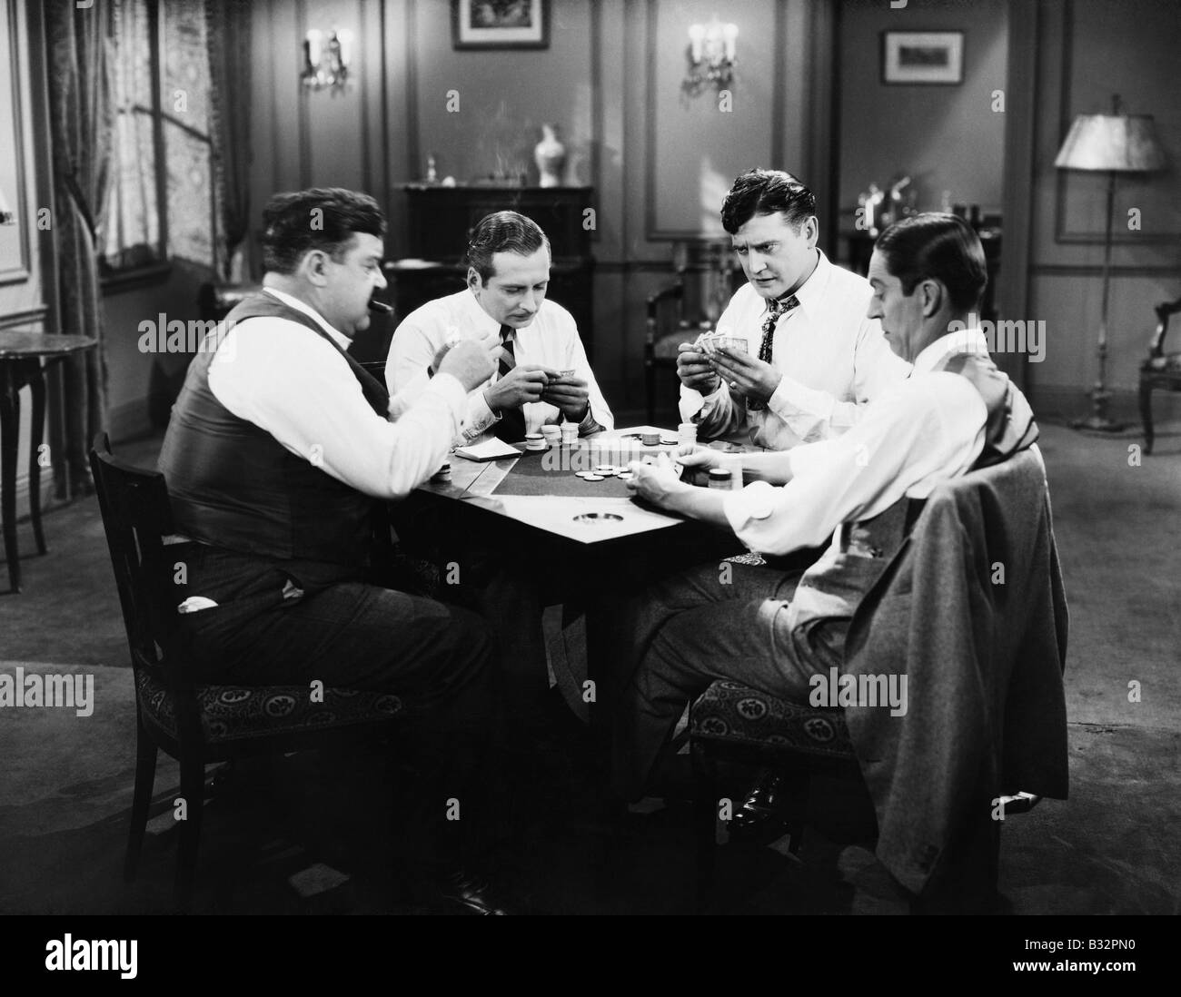 Four men playing cards - Stock Image