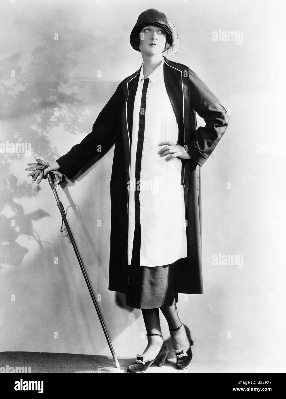Portrait of woman with cane and gloves - Stock Image