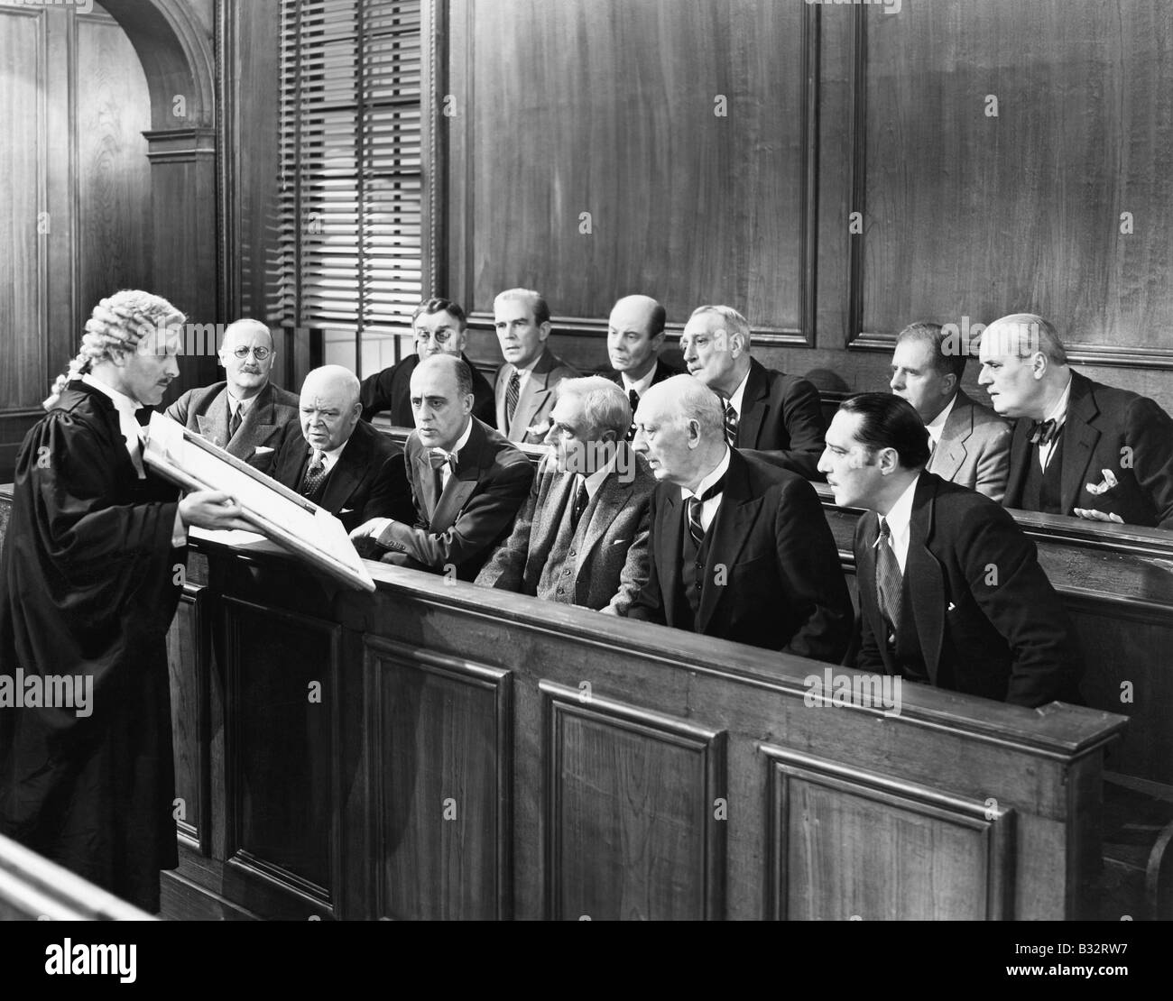Lawyer showing  evidence to the jury - Stock Image