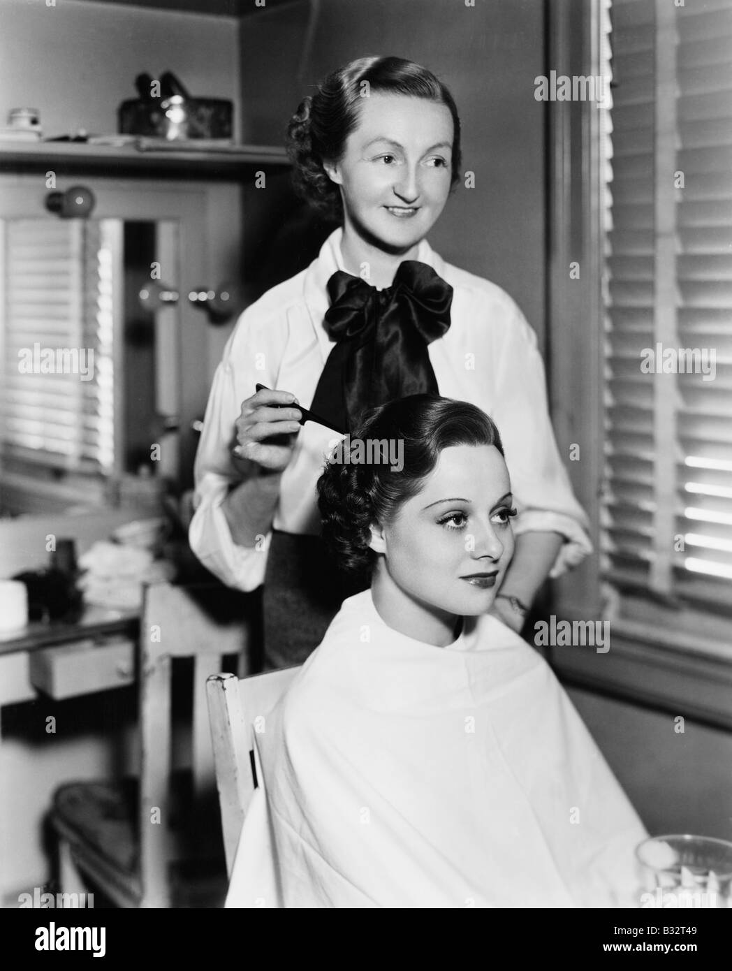 Young woman getting her hair done in a hair salon - Stock Image