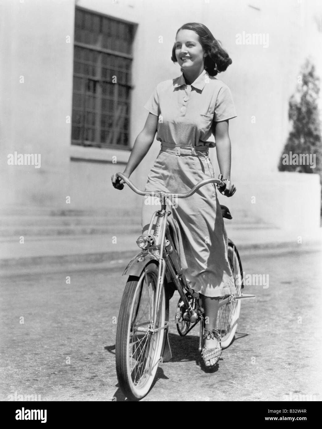 Young woman riding her bike Stock Photo