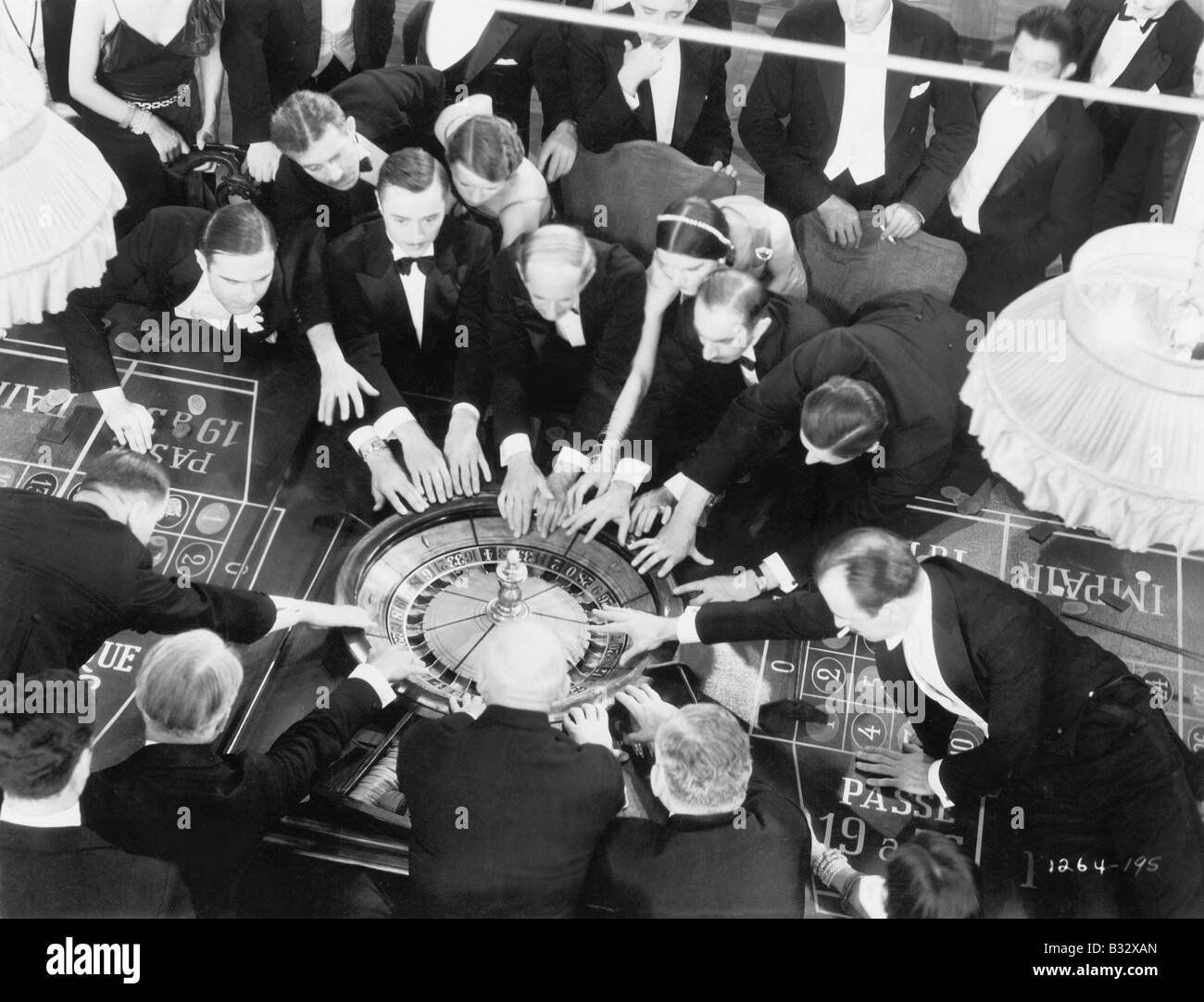 High angle of a group of people playing roulette - Stock Image