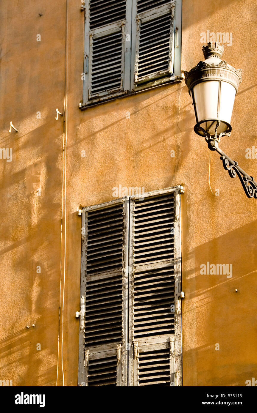 a Street lamp and Windows of an old building, Vieux Nice, Cote d'Azur, France - Stock Image