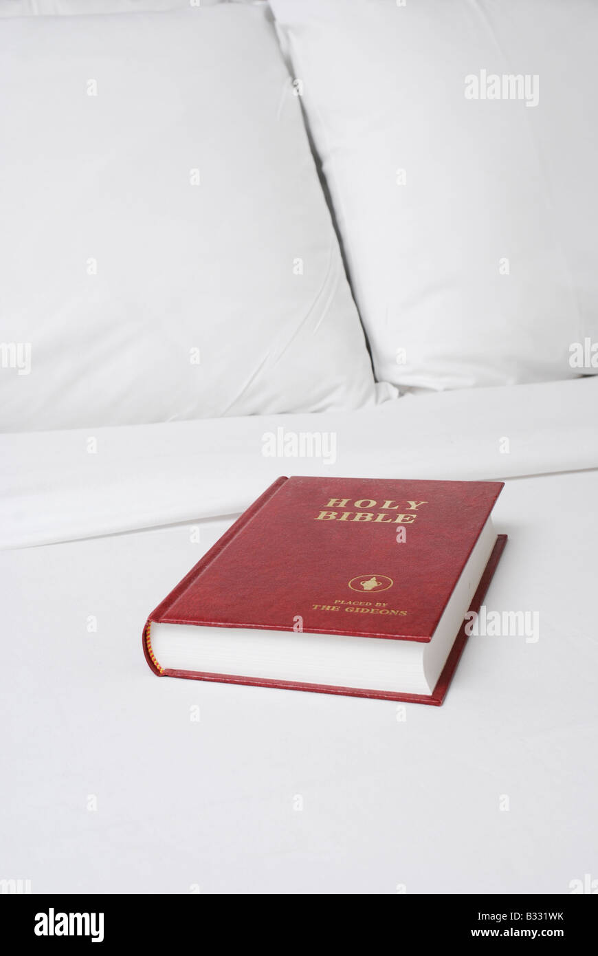 A bible left by the Gideons in a Hotel bedroom - Stock Image
