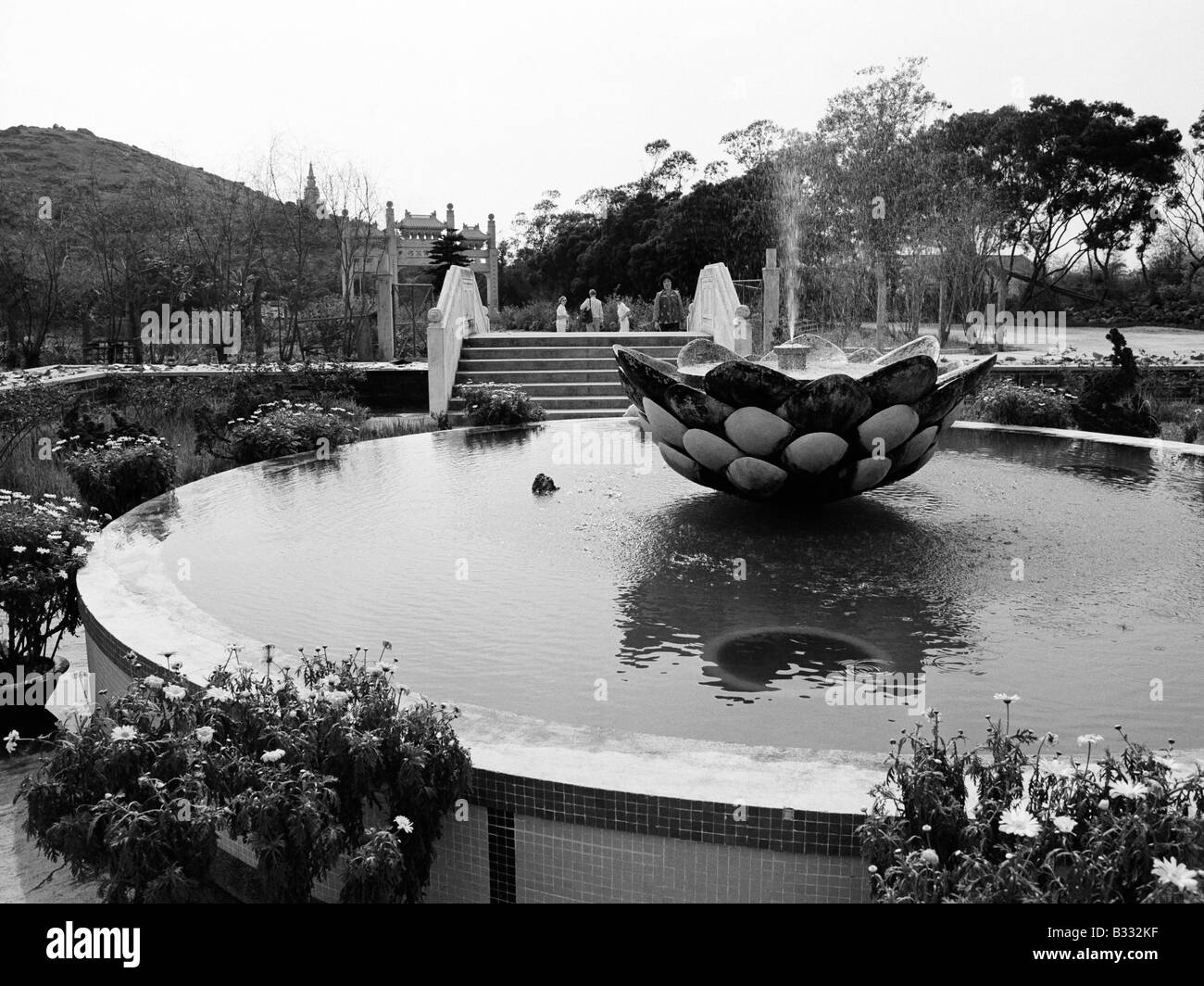 Lotus flower china black and white stock photos images alamy lotus flower fountain at po lin buddhist monastery lantau island hong kong 1979 stock image izmirmasajfo