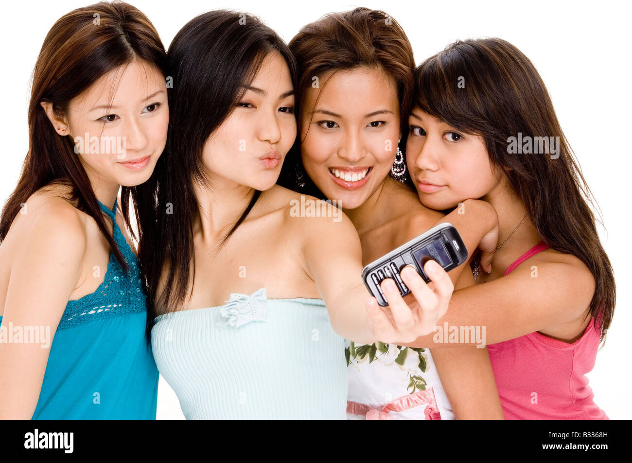 4ff8b34ef72 Four pretty young asian women taking their photo with their phone ...
