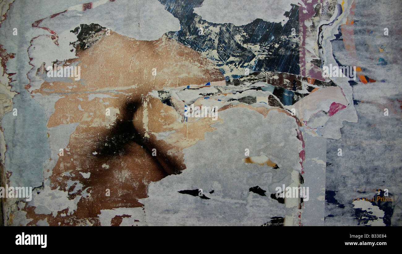 Abstract expressionist effect of peeled and torn layers of  temporary subway posters tempus fugit - Stock Image