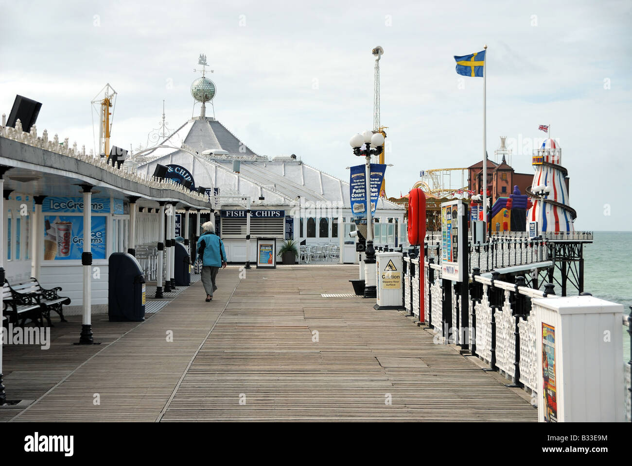 Fun Fair and Fish and Chip Shop on Brighton Pier - Stock Image