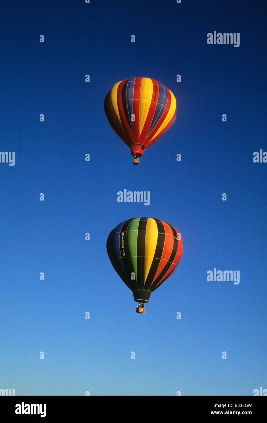 Hot-air balloons rise against blue sky, Perris, California, USA - Stock Image