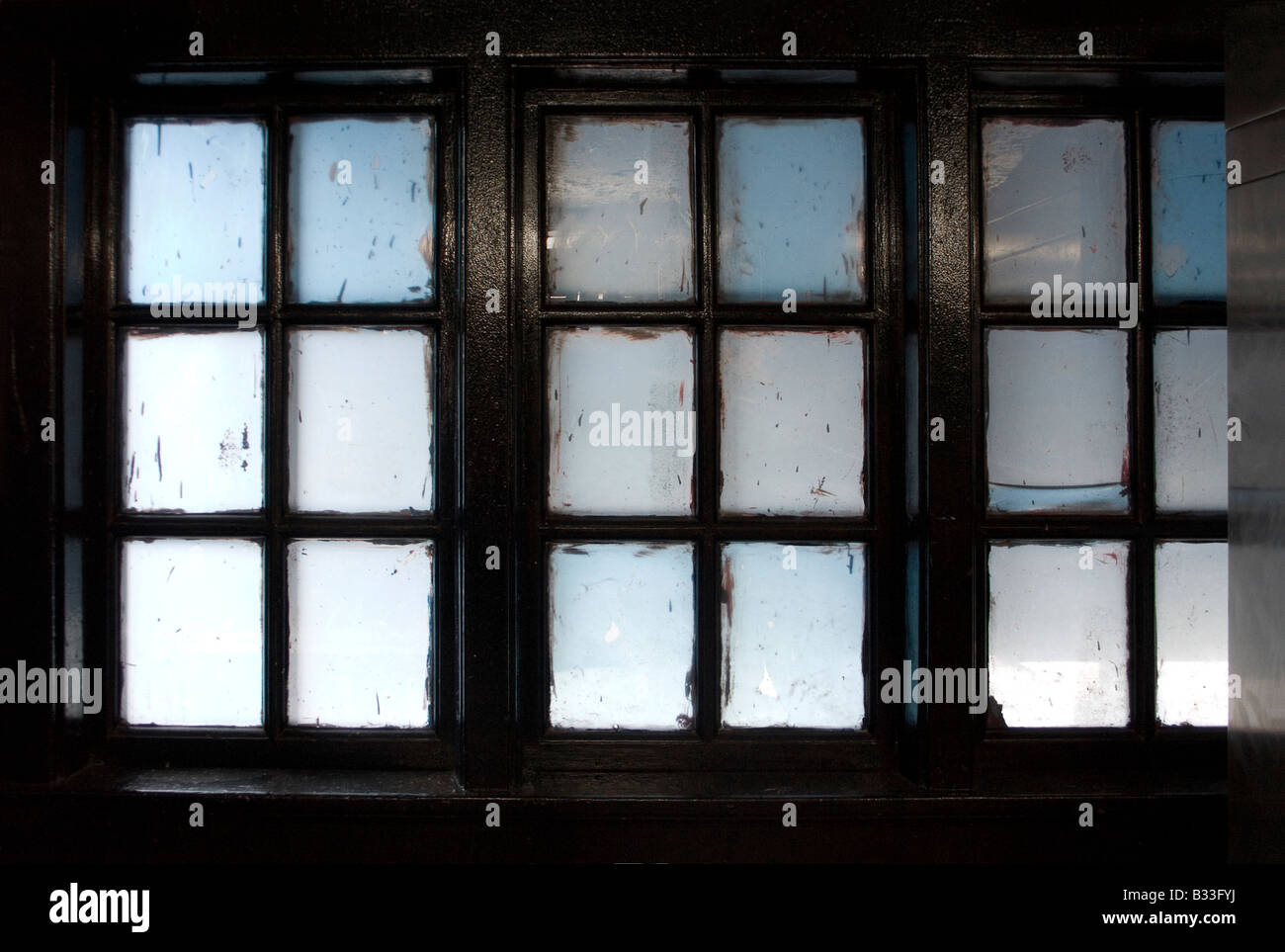 Six pane windows screen with opaque white and blue glass - Stock Image