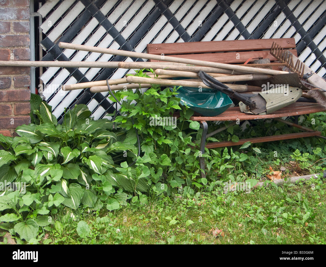 Yard tools on bench - Stock Image