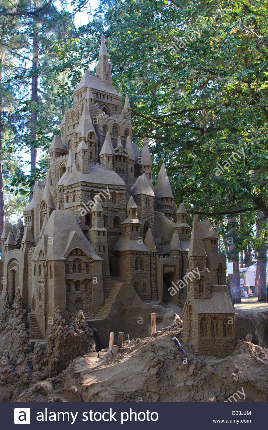 An enormous sandcastle in elaborate detail is still under construction during the Art on the Green festival in Coeur - Stock Image